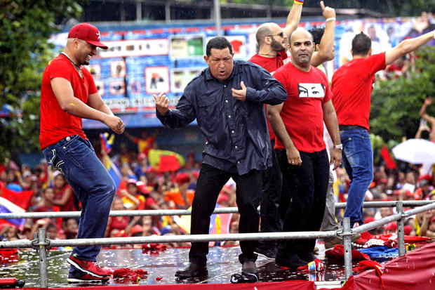 Chavez dances after speaking at his closing reelection campaign rally in Caracas on Oct. 4, 2012.