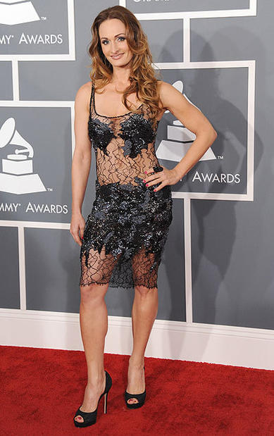 Singer songwriter D'manti arrives at the 2013 Grammys.
