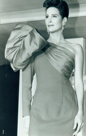 In 1988, big was in, as evidenced by the giant bow on this single-sleeve Victor Costa evening gown.
