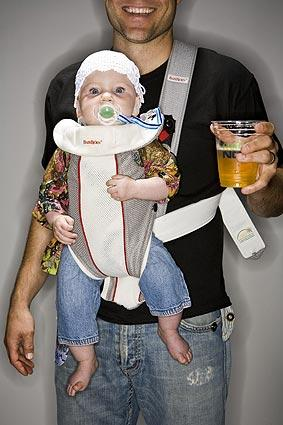 Brett Schafer, of Malibu, holds Vitalija, 6 months, and a cold brew in the Image section photo booth at L.A. Live's Club Nokia.