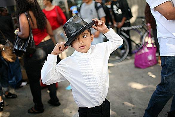 Eight-year-old Andrew Ocampo of Los Angeles does a Michael Jackson imitation near Staples Center prior to a memorial for the late pop star.