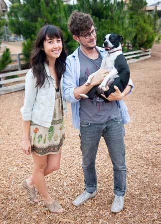 "Echo Park's Ali Lee, 25, and Bryan Hollon, 36, pose with Babel the Boston terrier, 2 1/2.  Bryan's T-shirt is from Blood is the New Black. Ali's dress is from Urban Outfitters and she wears Unearthen crystal necklaces. She says that she made a poor shoe choice, but that ""we weren't even planning on coming here."""