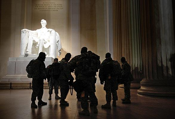 A group of soldiers pauses at the Lincoln Memorial before dawn on Inauguration Day. Barack Obama and his family visited the monument on the eve of his inauguration as the 44th president of the United States.