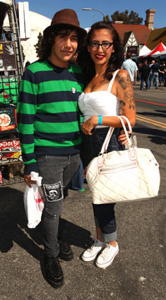 "Gino Benavidez and Andrea Elliot of La Puente, ""Just came for the bands and the tattoos,"" Elliot said."