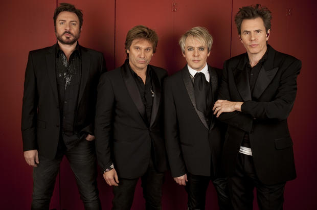 "Duran Duran's John Taylor, right, has written the memoir ""In the Pleasure Groove: Love, Death, and Duran Duran,"" which is being published this month. This 2011 photograph shows him with his original Duran Duran bandmates, minus guitarist Andy Taylor, who published the memoir ""Wild Boy"" in 2008."
