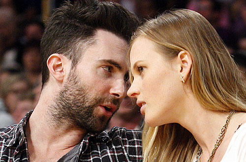 "Singer Adam Levine takes in the <a href="" http://www.latimes.com/sports/la-spw-lakers-lamar-odom2-2010mar02,0,6976862.story"">  <b>Lakers-Nuggets</b> </a> game at Staples  with a friend. <a href=""http://lakersblog.latimes.com/lakersblog/"">Talk about the Lakers with other fans at our Lakers blog.</a>"