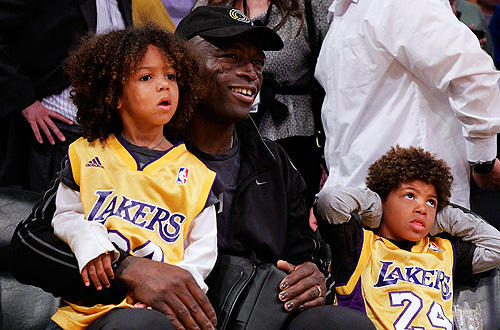 "Musician Seal takes his two sons to see the  <a href="" http://www.latimes.com/sports/la-sp-plaschke-lakers-20100428,0,1933869.column"">Lakers-Thunder </a>    Game 5 at Staples."