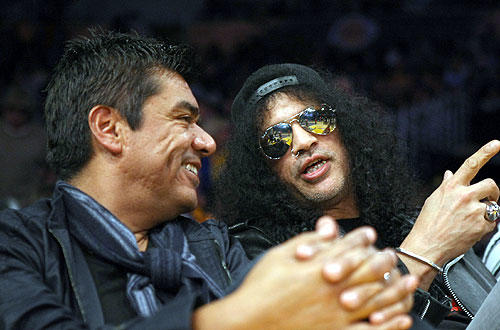 "Guitarist  Slash  and comedian George Lopez chat during the  <a href=""http://www.latimes.com/sports/la-sp-lakers-rockets16-2009nov16,0,5810971.story"">Lakers-Rockets </a>  game at Staples.  <a href=""http://lakersblog.latimes.com/lakersblog/"">Talk about the Lakers with other fans at our Lakers blog</a>."