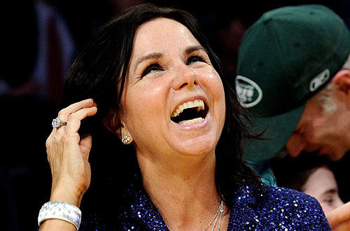 "Singer Patty Smyth  and tennis player John McEnroe  horse around at  the New Year's Day <a href=""http://www.latimes.com/sports/la-sp-lakers-kings2-2010jan02,0,3166437.story "">Lakers-Kings </a>  game at  Staples."