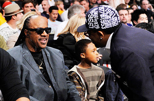 "Spike Lee greets Stevie Wonder. <a href=""http://lakersblog.latimes.com/lakersblog/"">Follow the purple and gold around the clock at our Lakers blog.</a>"