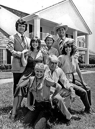 "The original cast of ""Dallas"" in front of Southfork Ranch. Clockwise from top right: Larry Hagman (in cowboy hat), Linda Gray, Jim Davis, Charlene Tilton, Patrick Duffy, Victoria Principal and Barbara Bel Geddes."