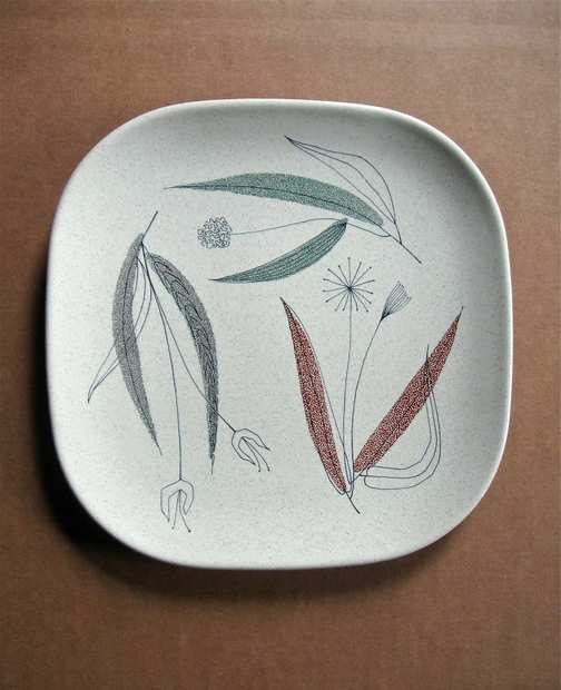 "Working in Los Angeles, Esta James designed the imagery for Franciscan Ware's 1954 Trio earthenware dinner plate. When the manufacturer rebuffed James' desire to incorporate her signature into the design, the artist did it anyway, hiding tiny letters spelling ""ESTA"" in the dandelion flower. (See next photo for detail.)"