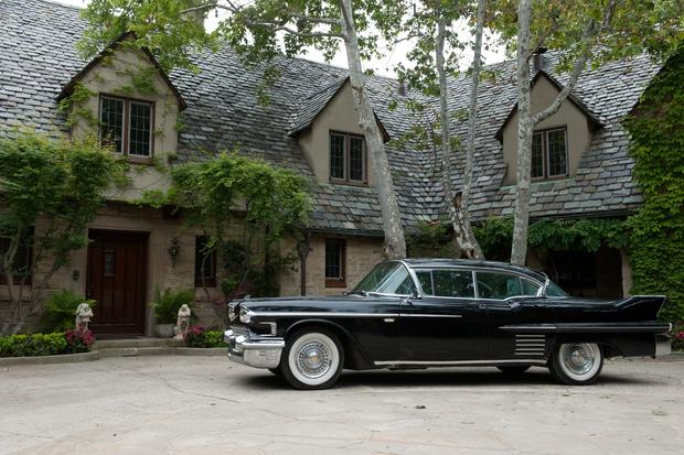 The exterior of the Hitchcock manor is an American Tudor in Beverly Hills with gables, a slate tile roof and a motor court large enough to accommodate a vintage Cadillac.