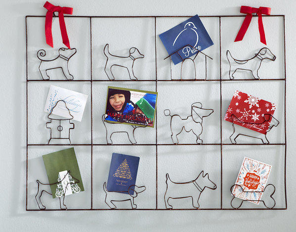 Red ribbons on the canine card holder hint at the holidays, but the reality is that when Christmas has passed, it could be used for photos -- an alternative to a multi-window picture frame. 
