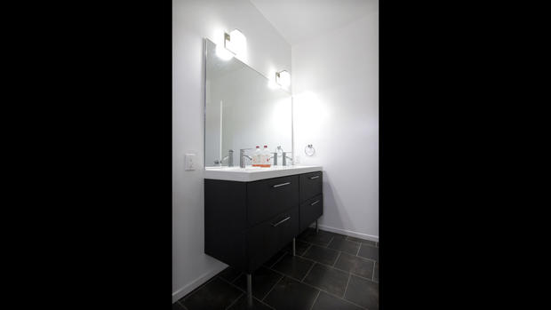 ... perhaps a photo of a new bathroom will alleviate the feeling. With the expectation of hard use and inevitable damage, the team chose vanities from Ikea so replacements would be easily accessible and inexpensive.