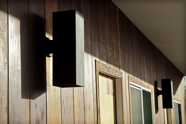 New exterior lighting and redwood siding are nods to the building's midcentury origins.