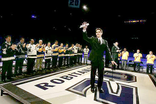 Kings officially retired Luc Robitaille's jersey No. 20 during a pregame ceremony Saturday at Staples Center. He is the highest scoring left wing in NHL history and the Kings' franchise leader in goals scored. Robitaille waves to fans as he is surrounded by former Kings players and coaches.