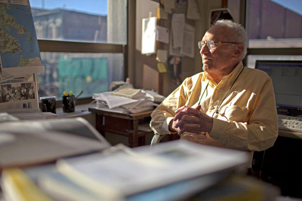 "David Perlman takes a break at his desk. He has outlived colleagues he has written with, scientists he has written about, Anne, his wife of 61 years.  ""I'm so lucky still to be able to do something, to do what I do.... I'm still pretty OK,"" he said. ""Anyway, as long as they'll have me [at the Chronicle], I'll stick around."""