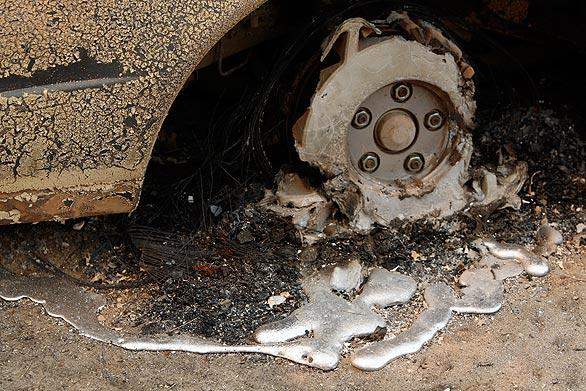 A car tire is completely melted by fire in Acton's Aliso Canyon.