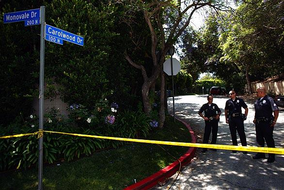 Police keep onlookers away from Michael Jackson's rented home in the Holmby Hills section of Bel Air.
