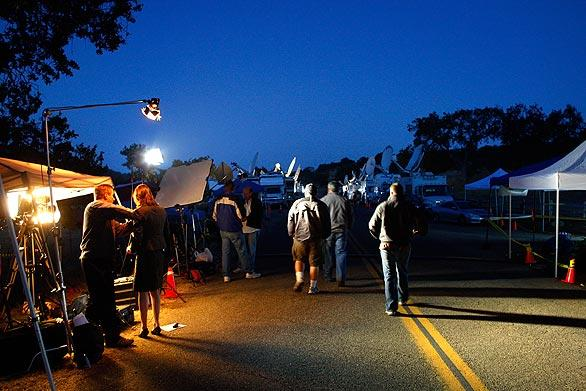 In the early-morning hours, media line Figueroa Mountain Road, leading to the gates of Michael Jackson's Neverland Ranch near Los Olivos.