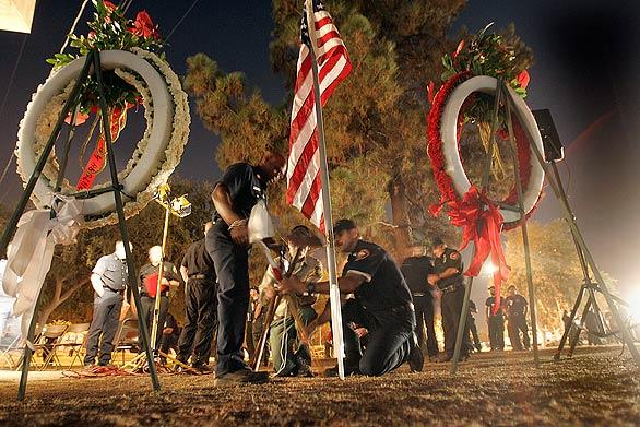 Before dawn Friday, firefighters build a small memorial to honor Hall and Quinones. A formal memorial is planned for 10 a.m. Saturday at Dodger Stadium.