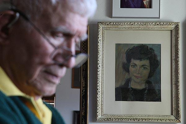 Alan Purdy, 88, is shown in front of a painting of his late wife, Margaret. He sat by while she took her own life March 20; but San Diego County sheriff's deputies determined there was sufficient evidence to support arresting him on a charge of assisting a suicide, a felony. The district attorney's office is reviewing whether to file a criminal charge against Purdy.