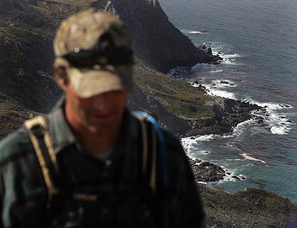 "Trail coordinator Ryan walks about 600 feet above the ocean. ""In a place like this, it's hard to complain about coming to work every day,"" he said with a smile."