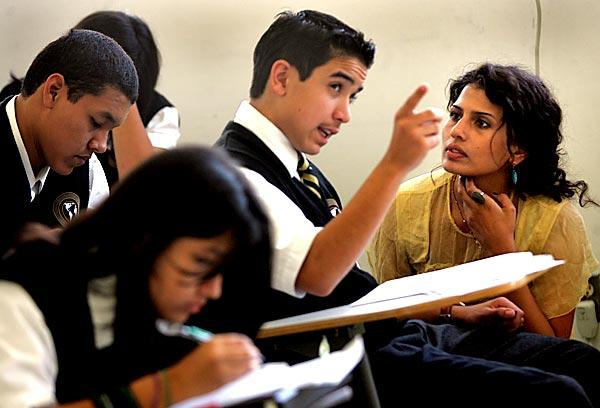 Freshman Andrew Moldonado, 13, asks English teacher Maryem Irias a question during class at the Los Angeles International Charter High School in Hermon. The explosive growth of charter schools has challenged the status quo in the L.A. Unified School District.