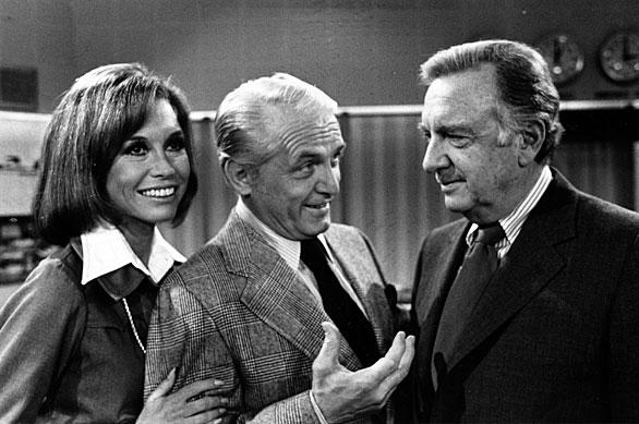 "Cronkite, right, meets with actors Ted Baxter and Mary Tyler Moore. He appeared with them on ""The Mary Tyler Moore Show"" on Feb. 4, 1974."