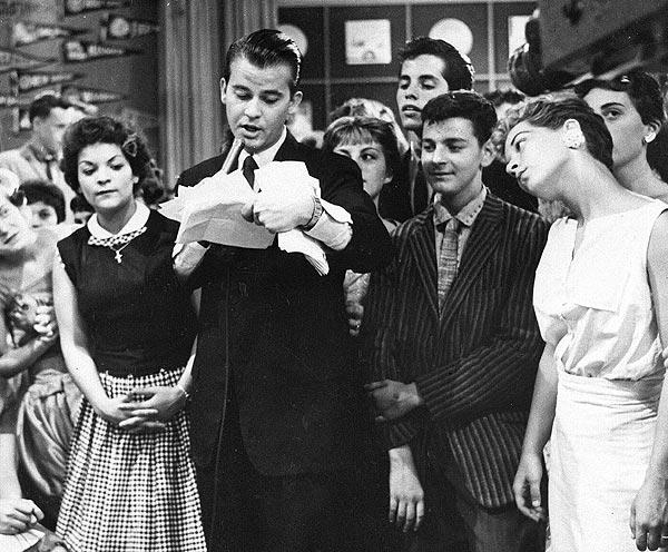"Dick Clark during a television broadcast of ""American Bandstand"" in 1957."