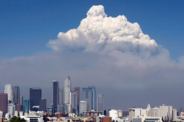 A towering pyrocumulus cloud created by the Station fire in Angeles National Forest billows into a blue sky behind downtown Los Angeles.