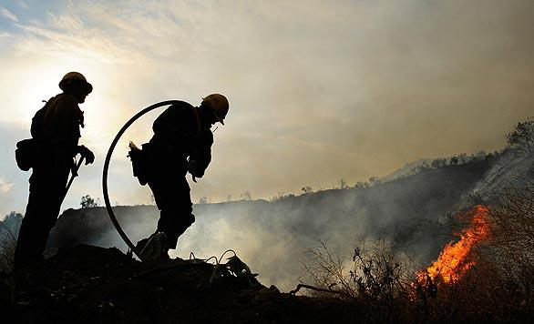 U.S. Forest Service firefighters battle the Station fire along Angeles Crest Highway in La Ca?ada Flintridge.