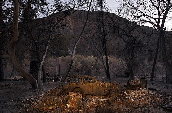 An incinerated car sits in the devastated hamlet of Vogel Flats, which is along Big Tujunga Canyon Road in the Angeles National Forest.
