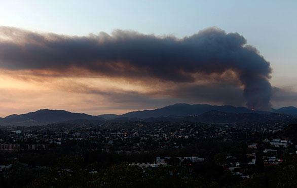 Smoke fills the air from a two-day-old  brush fire north of La Canada Flintridge.  The blaze started Wednesday near the Angeles Crest Highway around mile marker 29.