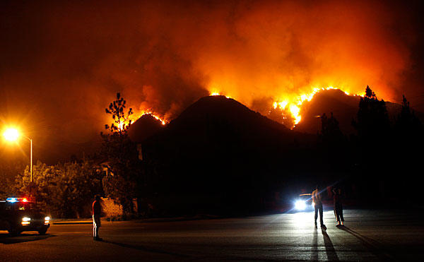 A brush fire above La Canada Flintridge moves down a canyon toward Angeles Crest Highway  just before midnight Thursday.