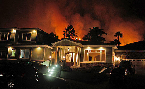 Flames threaten a home on San Gorgonio Road in La Ca?ada Flintridge.