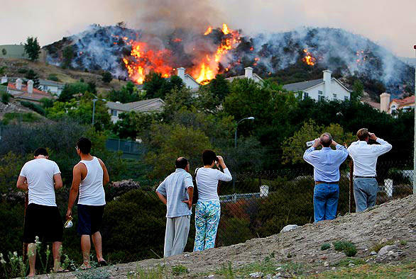 Residents View flames from Boston Avenue as the burn behind Sky Ridge Drive in La Crescenta.