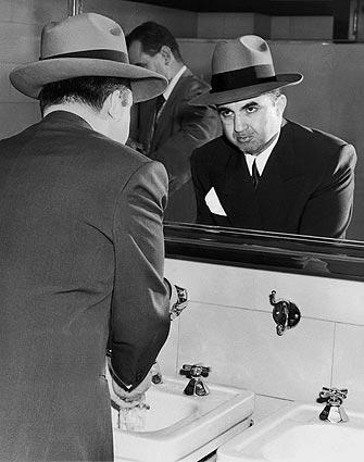 Gangster Mickey Cohen with one of his compulsions: washing his hands.