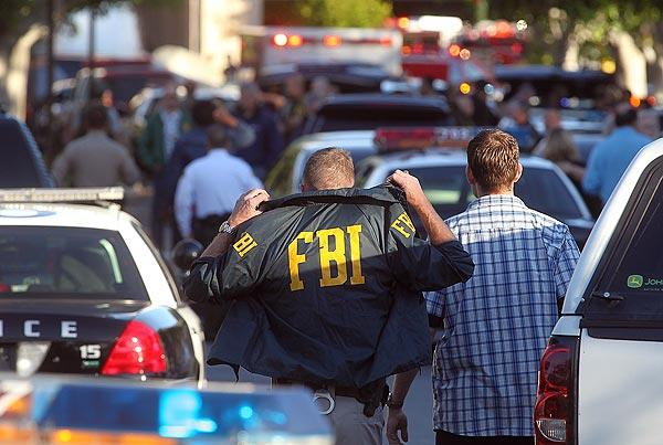 FBI agents arrive on the scene after a shooting in a Southern California Edison office in Irwindale.