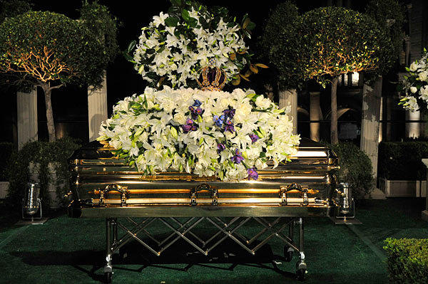 Michael Jackson's casket, elaborately adorned by flowers, sits at his funeral at Forest Lawn Memorial-Park in Glendale.