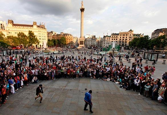 Michael Jackson fans watch as a dance is performed in his memory in central London's Trafalgar Square.