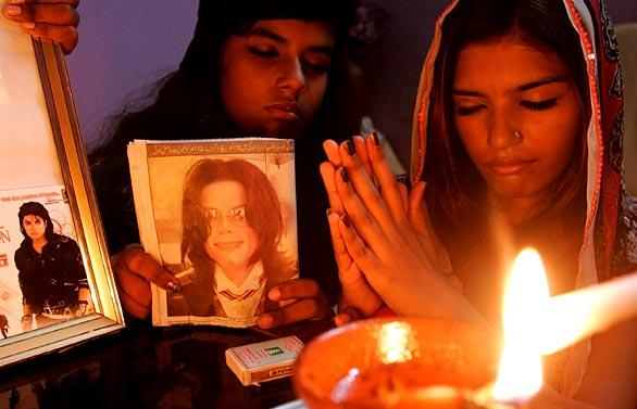 Christian girls in Karachi, Pakistan, participate in a candlelight memorial.