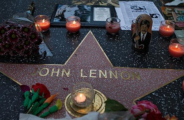 Fans leave mementos on John Lennon's star outside the Capitol Records building to celebrate his 72nd birthday.