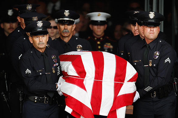 The funeral service for LAPD Officer Robert J. Cottle, killed March 24 in Afghanistan while on Marine Reserve duty,  is held at the Cathedral of Our Lady of the Angels in Los Angeles. <br>