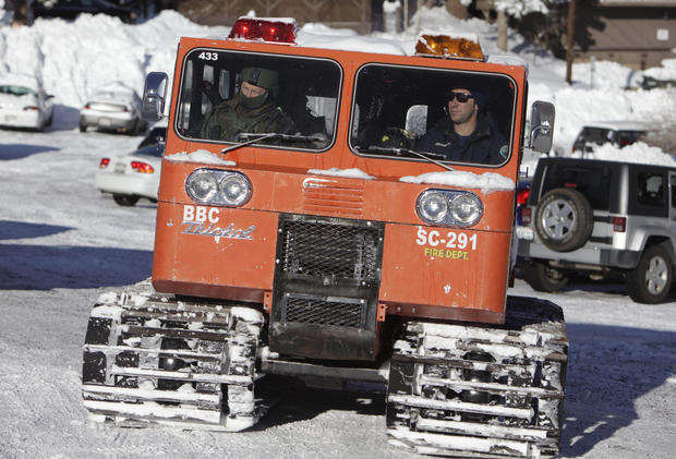 Officers in a snow cat head out to search remote areas of the Big Bear area.