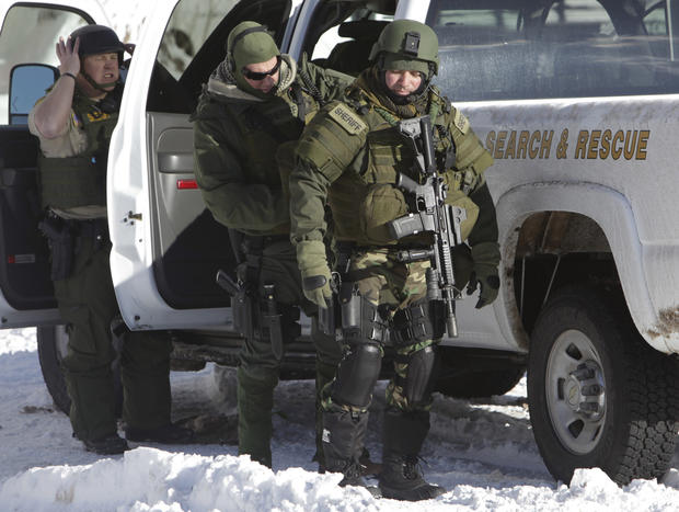San Bernadino County Sheriff Search and Rescue personnel gear up for the manhunt in the Big Bear area.
