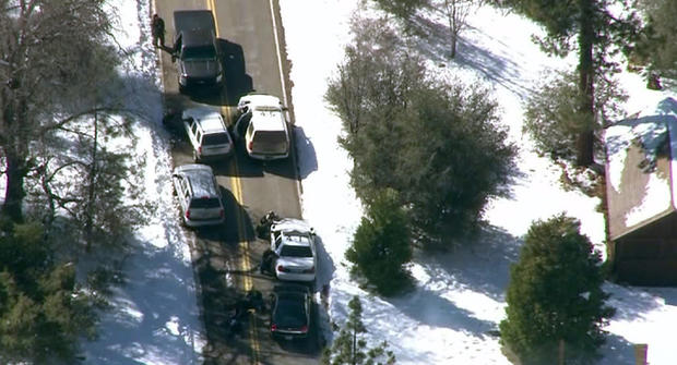 Fugitive former police officer Christopher Dorner allegedly shot and wounded at least two San Bernardino County sheriff's deputies during a shootout with authorities in the Big Bear area Tuesday afternoon, sources said.