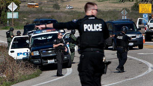 Officers from several law enforcement agencies man a roadblock on Highway 38 north of Redlands.