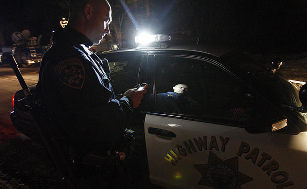 A California Highway Patrolman at checkpoint along Highway 38 near Big Bear. Roads are still closed in the area around the cabin.